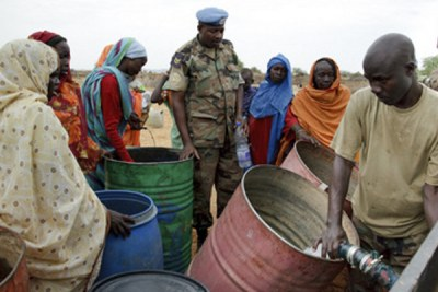 Water distribution by UNAMID in Tora, Northern Darfur