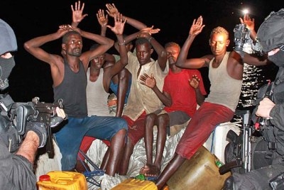 A group of Somali pirates are apprehended by several Portuguese marines.