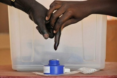 A man has his finger dipped in indelible ink after voting (file photo).