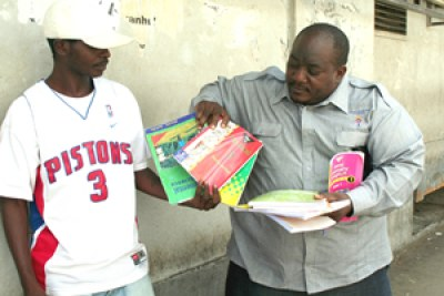 Raymond Majongwe takes books from vendors at Ximex Mall.