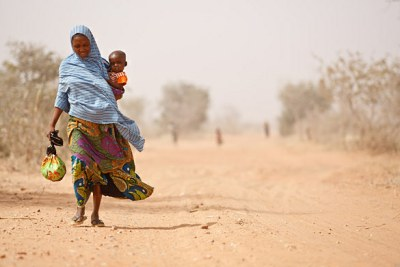 A woman and her malnourished son. Aid workers say 4.6 million Malians are affected by the hunger crisis, including 175,000 children who face life-threatening severe malnutrition.