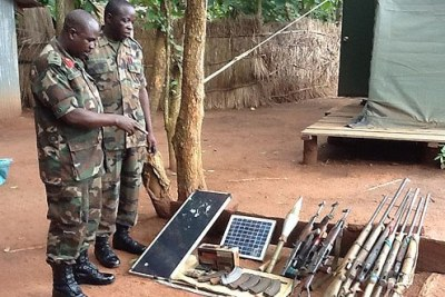 Ugandan military officers survey the ammunition captured from the Lord's Resistance Army.
