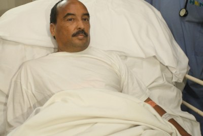 President Abdel Aziz in his French hospital bed after being shot in an apparent accident.