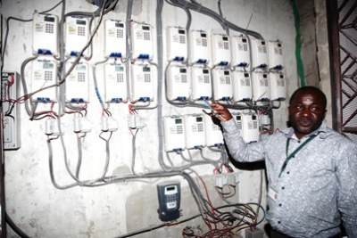 Tanzania Electric Supply Company Limited employee shows electric meters. The company has been plagued with alleged cases of corruption.