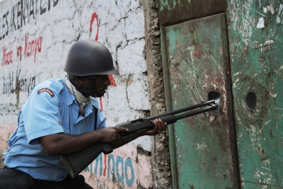 Anti-riot police secure Nairobi's Eastleigh area, which has been hit by violent protests following the bombing of a minibus.