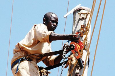 Umeme officer doing maintenance work.