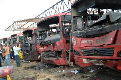 Burnt-out busses after an attack at a bus station packed with morning commuters in Abuja