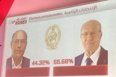 Béji Caïd Essebsi (right) was elected following a runoff vote.