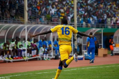 Rwanda star Sugira wheels away to celebrate his goal.