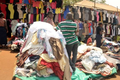 Heaps of second-hand clothes stacked together in Uganda.