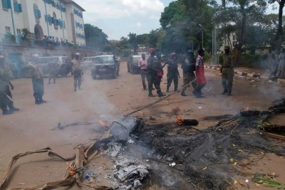 The striking students burning tyres at Makerere university.