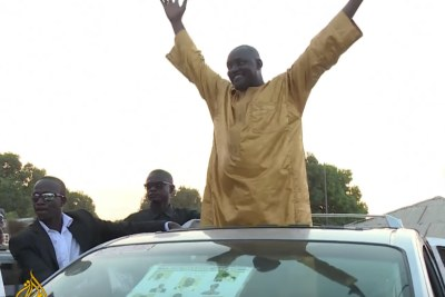 Gambia's president-elect Adama Barrow acknowledges crowds in this news clip from Al Jazeera television news.