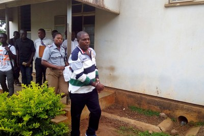 Genocide suspect Vincent Murekezi leaves a court in Malawi (file photo)
