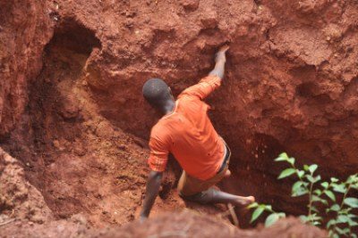 A youth miner entering a pit in Nabwal Mining Camp.