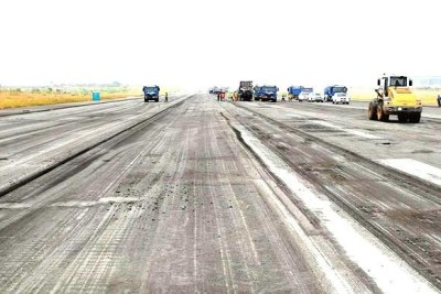 Repair work progresses on the runway of Nnamdi Azikiwe International Airport in Abuja.