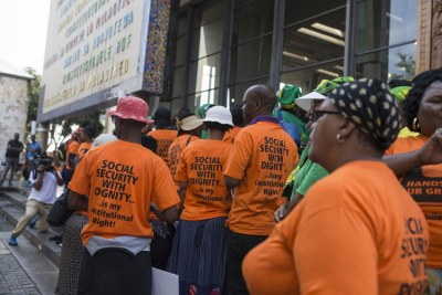 Demonstrators outside the Constitutional Court during hearings on the future of the social grants payment system.