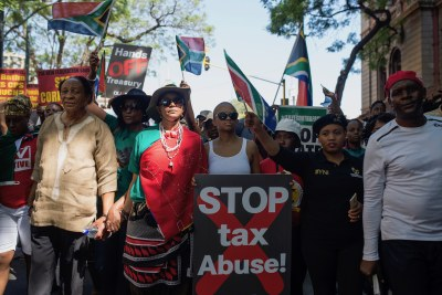 Protesters march to the Union Buildings to demonstrate against President Zuma's decision to fire his finance minister (file photo).