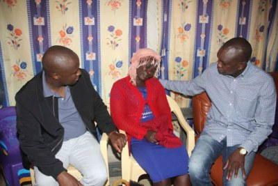 Nandi Hills MP Alfred Keter, left, and Kapsaret MP Oscar Sudi console Ebby Isaji, wife of James Ratemo Onsare, a ward rep aspirant for Kapsoya Ward following the death of her three sons.