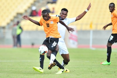Donashano Malama of Zambia challenged by Thero Setsile of Botswana.