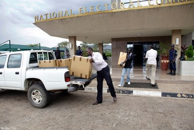 National Electoral Commission staffers load voters kits on a truck during a past election.