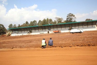 Construction workers at the Kinoru stadium in Meru last week. The stadium was one of five others chosen to host the African Nations Championship (CHAN) games but Kenya was at the weekend stripped of her rights to manage the event, which will start in January. African football chiefs said Kenya was not prepared for the 16-nation showpiece because the stadiums are incomplete.