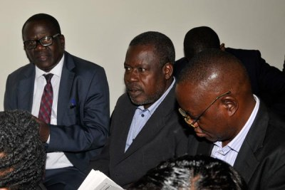 Former transport and works minister Abraham Byandala, left, appearing with Ssebugga Kimeze, centre, and Joe Semugooma before the anti-corruption court in Kololo recently.