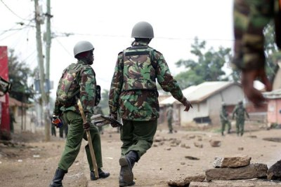 Anti-riot police officers patrol Nyalenda, in Kisumu County (file photo).