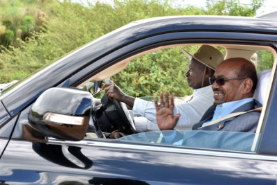 President Yoweri Museveni and President Omar al-Bashir at Kisozi farm on Tuesday.