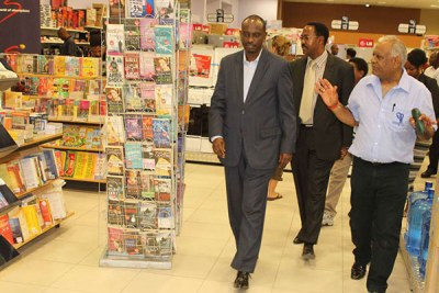 Former East African Community secretary general Richard Sezibera, Arusha Mayor Gaudence Lyimo and Nakumatt MD Atul Shah at the retailer's Arusha branch.