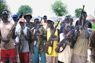 Boys and men carrying arms in Jonglei State in 2006.