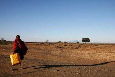 A girl carries water, northeastern Uganda, March 2007.