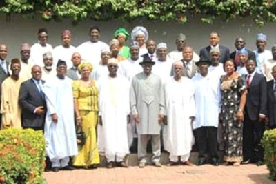 Acting President Goodluck Jonathan (middle) in a group photograph with members of the Federal Cabinet shortly after the re-constitution of the Executive Council of the Federation at the State House, Abuja.