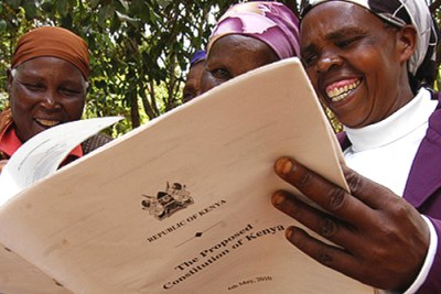 Faithfuls at Riamukurwe PCEA church in Nyeri read a copy of the proposed constitution.