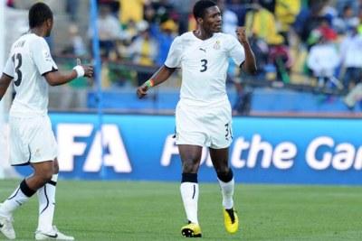 Asamoah Gyan of Ghana celebrates his goal against Australia.