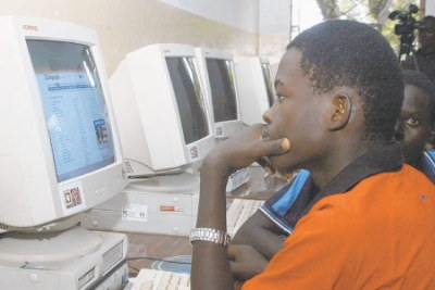 Residents browse the Internet at an East African community centre.