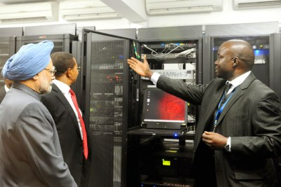 Indian Prime Minister, Dr. Manmohan Singh, left, was briefed about a super computer at the India-Tanzanian Centre in Information and Communication Technology, in Dar es Salaam, Tanzania on May 27, 2011.