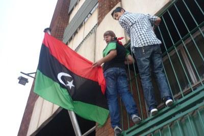 Libyans living in Zimbabwe celebrate the toppling of Muammar al-Gaddafi's regime.
