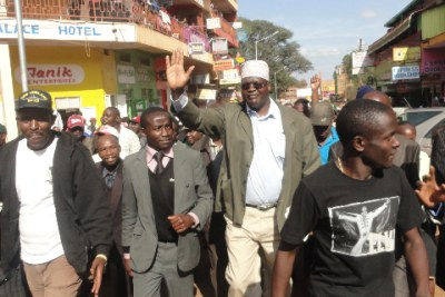 Former prime minister''s adviser Miguna Miguna in Nyeri town with residents after promoting his book