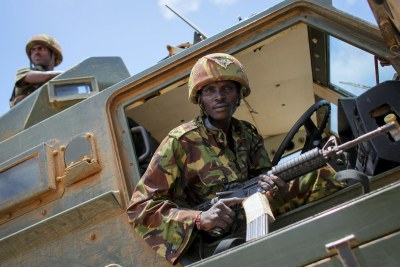 Kenyan soldiers of the African Union Mission in Somalia are pictured inside their armoured personnel carrier on the grounds of Kismayo University, southern Somalia.