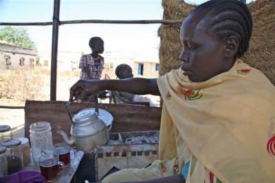 Tea seller Achuil Deng now only sells a few cups a day oustide an abandoned Abyei school.