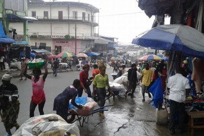 Traders in Monrovia's largest market district of Waterside on the morning the quarantine was lifted off West Point that's nearby.