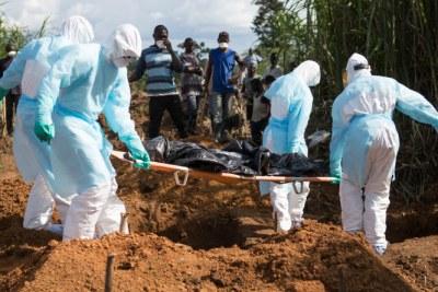 Burying Ebola victims in Sierra Leone.