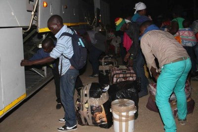 Zimbabweans leave South Africa following xenophobic violence.
