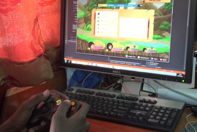 A Kiro'o Games programmer tests a build of video game the Aurion: Legacy of the Kori-Odan for bugs (file photo).