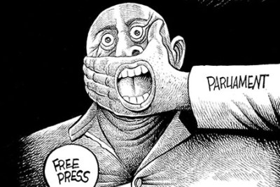 Cartoon depicting restrictions on the media.