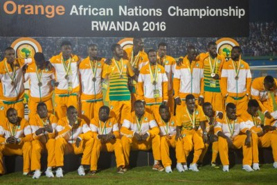 Third place playoff winners Ivory Coast pose for a group photo after receiving their medals- CHAN 2016 Rwanda