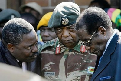 From left, Intelligence boss Happyton Bonyongwe, Army Commander Constantine Chiwenga and President Robert Mugabe.