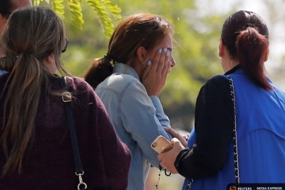 Unidentified relatives and friends of passengers who were flying in an EgyptAir plane wait outside the Egyptair in-flight service building in Cairo.