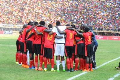 The Uganda Cranes team praying (file photo).