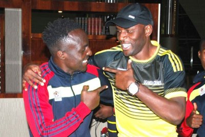 Uganda Cranes stars Tonny Mawejje and Geoffrey Massa celebrating the New Year at Dubai International Airport.